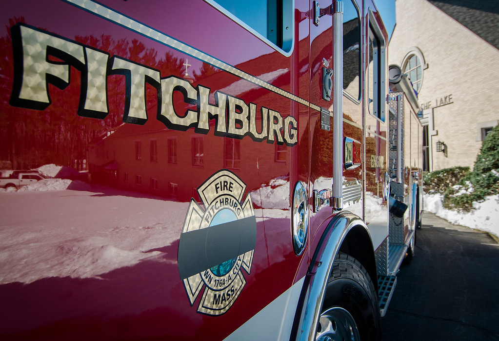 """. The black mourning band covers the city seal on a Fitchburg Fire Department engine during the funeral of firefighter Jack Mulcahy at Our Lady of the Lake Church in Leominster on Monday, March 20, 2017. Jack \""""Mulky\"""" Mulcahy, who served 41 years on the department, died Wednesday, March 15, after a 16-month battle with pancreatic cancer. He was 63. SENTINEL & ENTERPRISE / Ashley Green"""