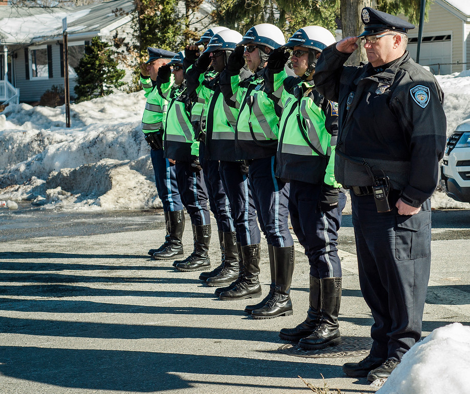 """. Members of the Fitchburg Police Department salute as the funeral procession of Fitchburg Firefighter Jack Mulcahy makes its way up Main Street on the way to Our Lady of the Lake Church in Leominster on Monday, March 20, 2017. Jack \""""Mulky\"""" Mulcahy, who served 41 years on the department, died Wednesday, March 15, after a 16-month battle with pancreatic cancer. He was 63. SENTINEL & ENTERPRISE / Ashley Green"""