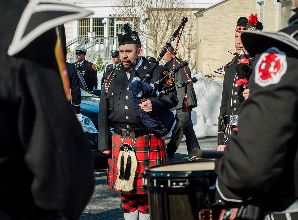 ". The funeral procession of Fitchburg Firefighter Jack Mulcahy arrives at Our Lady of the Lake Church in Leominster on Monday, March 20, 2017. Jack ""Mulky\"" Mulcahy, who served 41 years on the department, died Wednesday, March 15, after a 16-month battle with pancreatic cancer. He was 63. SENTINEL & ENTERPRISE / Ashley Green"