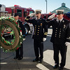 "The funeral procession of Fitchburg Firefighter Jack Mulcahy makes a stop at Central Station for a wreath-laying ceremony on Monday, March 20, 2017. Jack ""Mulky"" Mulcahy, who served 41 years on the department, died Wednesday, March 15, after a 16-month battle with pancreatic cancer. He was 63. Firefighter Patrick Haverty, Retired Deputy Chief Dave Rousseau and Lt. Jack Gilmartin lay the wreath. SENTINEL & ENTERPRISE / Ashley Green"