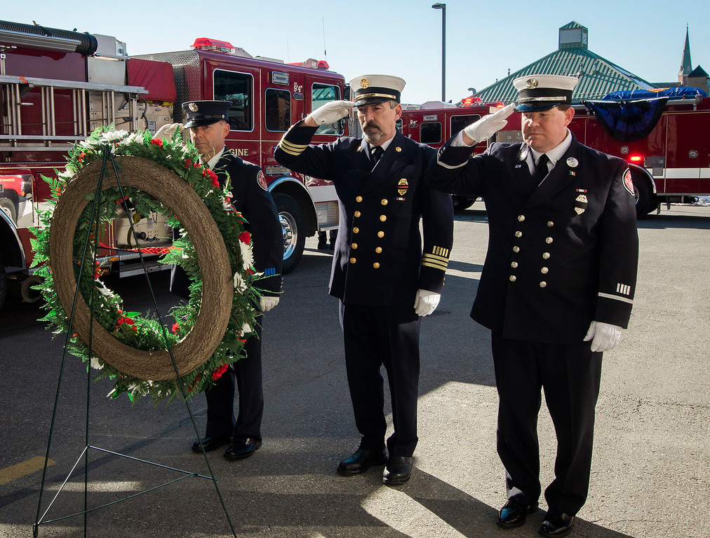 """. The funeral procession of Fitchburg Firefighter Jack Mulcahy makes a stop at Central Station for a wreath-laying ceremony on Monday, March 20, 2017. Jack \""""Mulky\"""" Mulcahy, who served 41 years on the department, died Wednesday, March 15, after a 16-month battle with pancreatic cancer. He was 63. Firefighter Patrick Haverty, Retired Deputy Chief Dave Rousseau and Lt. Jack Gilmartin lay the wreath. SENTINEL & ENTERPRISE / Ashley Green"""