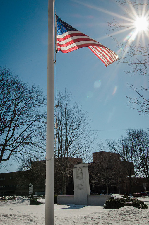 ". An American flag can be seen at half-staff at the firemen\'s memorial in honor of Fitchburg Firefighter Jack Mulcahy following his funeral on Monday, March 20, 2017. Jack ""Mulky\"" Mulcahy, who served 41 years on the department, died Wednesday, March 15, after a 16-month battle with pancreatic cancer. He was 63. SENTINEL & ENTERPRISE / Ashley Green"