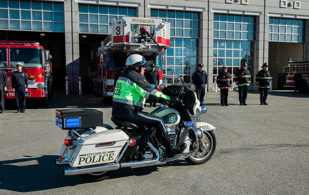""". The funeral procession of Fitchburg Firefighter Jack Mulcahy makes a stop at Central Station for a wreath-laying ceremony on Monday, March 20, 2017. Jack \""""Mulky\"""" Mulcahy, who served 41 years on the department, died Wednesday, March 15, after a 16-month battle with pancreatic cancer. He was 63. SENTINEL & ENTERPRISE / Ashley Green"""