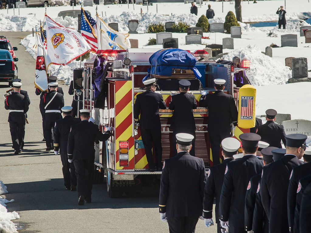 ". The funeral procession of Fitchburg Firefighter Jack Mulcahy arrives at St. Bernard\'s Cemetery in Fitchburg on Monday, March 20, 2017. Jack ""Mulky\"" Mulcahy, who served 41 years on the department, died Wednesday, March 15, after a 16-month battle with pancreatic cancer. He was 63. SENTINEL & ENTERPRISE / Ashley Green"