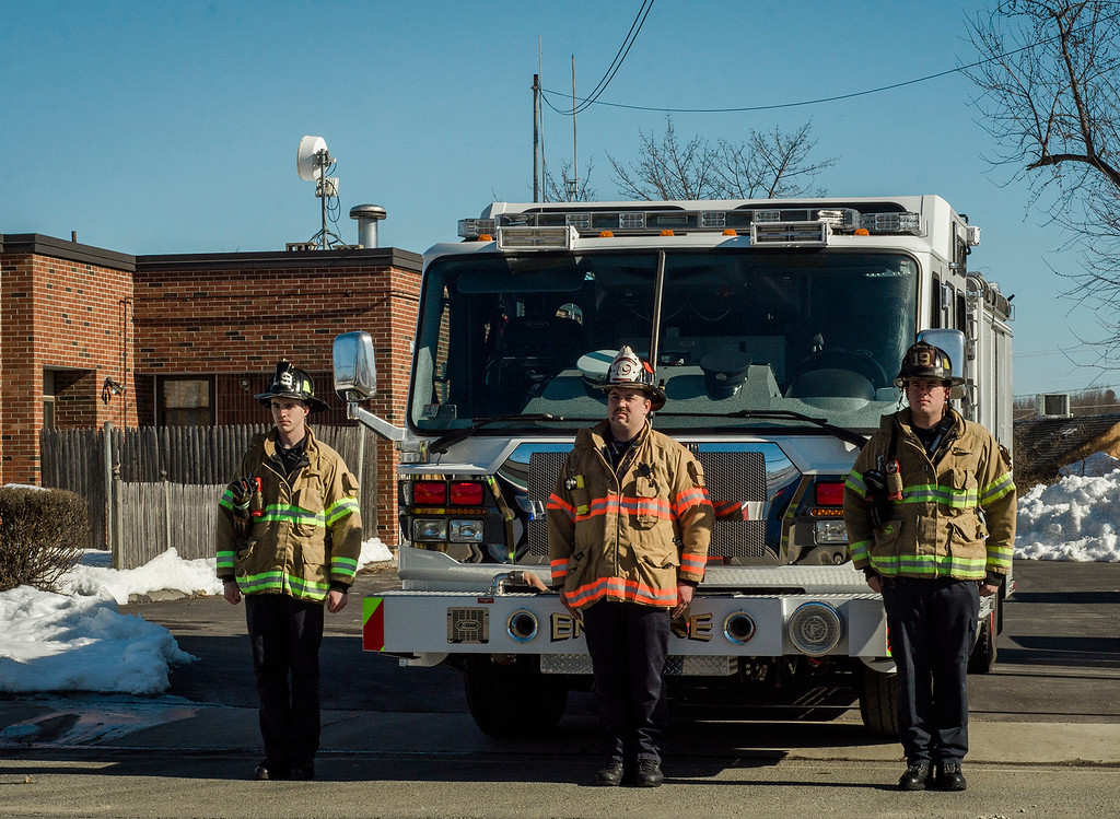 ". A Lunenburg fire engine and firefighters stand at attention after the funeral procession of Fitchburg Firefighter Jack Mulcahy passes by the Summer Street station on Monday, March 20, 2017. Jack ""Mulky\"" Mulcahy, who served 41 years on the department, died Wednesday, March 15, after a 16-month battle with pancreatic cancer. He was 63. SENTINEL & ENTERPRISE / Ashley Green"