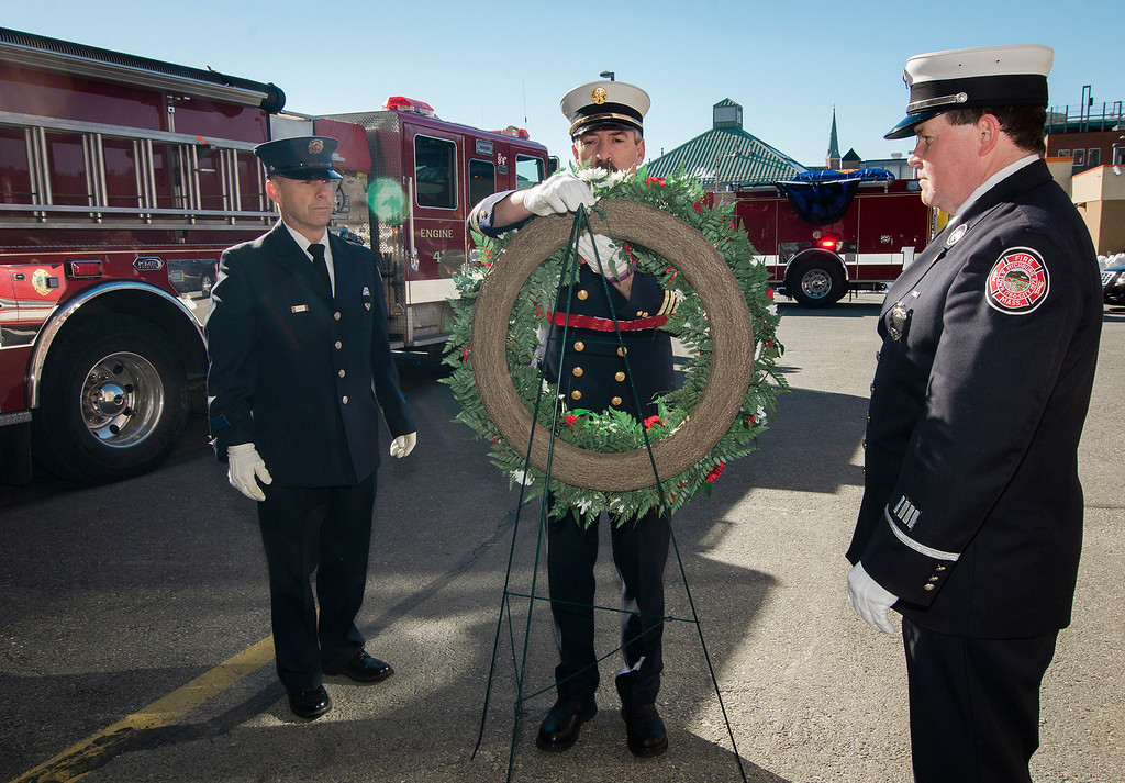 ". The funeral procession of Fitchburg Firefighter Jack Mulcahy makes a stop at Central Station for a wreath-laying ceremony on Monday, March 20, 2017. Jack ""Mulky\"" Mulcahy, who served 41 years on the department, died Wednesday, March 15, after a 16-month battle with pancreatic cancer. He was 63. Firefighter Patrick Haverty, Retired Deputy Chief Dave Rousseau and Lt. Jack Gilmartin lay the wreath. SENTINEL & ENTERPRISE / Ashley Green"