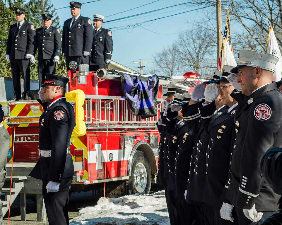 """. The funeral procession of Fitchburg Firefighter Jack Mulcahy arrives at Our Lady of the Lake Church in Leominster on Monday, March 20, 2017. Jack \""""Mulky\"""" Mulcahy, who served 41 years on the department, died Wednesday, March 15, after a 16-month battle with pancreatic cancer. He was 63. SENTINEL & ENTERPRISE / Ashley Green"""