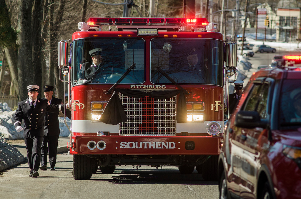 """. The funeral procession of Fitchburg Firefighter Jack Mulcahy makes its way up Main Street on the way to Our Lady of the Lake Church in Leominster on Monday, March 20, 2017. Jack \""""Mulky\"""" Mulcahy, who served 41 years on the department, died Wednesday, March 15, after a 16-month battle with pancreatic cancer. He was 63. SENTINEL & ENTERPRISE / Ashley Green"""