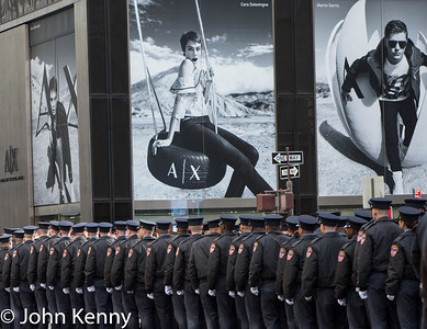 """A line of FDNY trainees, or """"probes,"""" lined up beneath large billboards adjacent to St. Patrick's Cathedral.     Davidson funeral 3/27/18"""