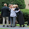 EXCHANGE-Mourner Hug as the get to the funeral of Vanessa Marcotte at Our Lady of the Lake Church on Main Street in Leominster. SENTINEL & ENTERPRISE/JOHN LOVE