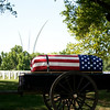 """The caisson, bearing the casket of Col. Clem Robert """"Bob"""" Lawson USAF, passes in front of the Air Force Memorial, Arlington National Cemetery, July 8, 2009"""