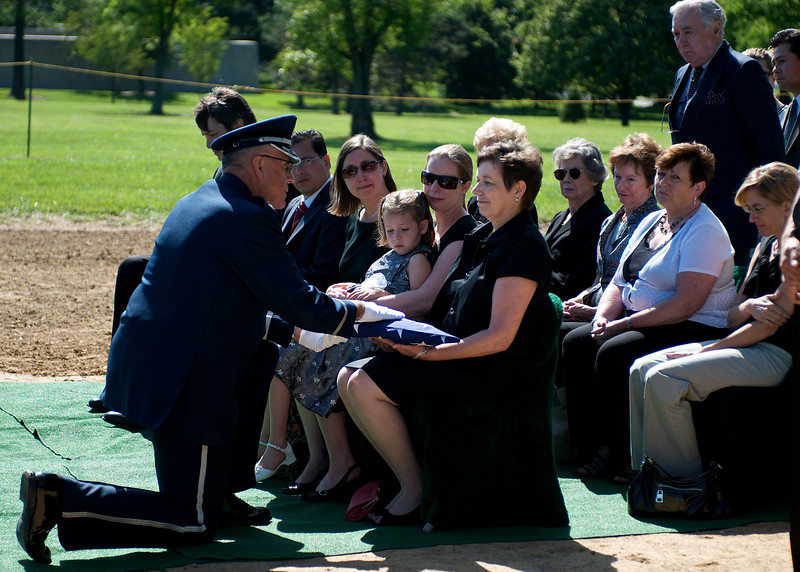 The chaplain presents the flag to Mary Lawson. Arlington National Cemetery, July 8, 2009