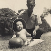 ORY JENKINS with son Woody, age 1, not to be confused with the watermelon, on the Tickfaw River in Tangipahoa Parish, Louisiana.  1947
