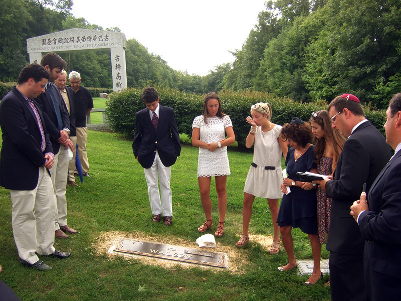 Elliot Walsey gravestone unveiling -  FRONT (around gravestone): Brian Hyman, left front; Jeremy Solomon, 2nd on left front; Jackie Hyman, 4th on right; Gabriela Lynne Hyman, 3rd on right; Lindsay Sarah Hyman, 2nd on right; Joan (née Somerstein)Walsey, 4th on right; Alexandra Solomon, 3rd on right; Rabbi; Alex Hyman, right REAR (under Chinese writing): Ric Berry, rear left; Irwin Solomon, right rear - Joan Walsey's husband Elliot Walsey's gravestone unveiling