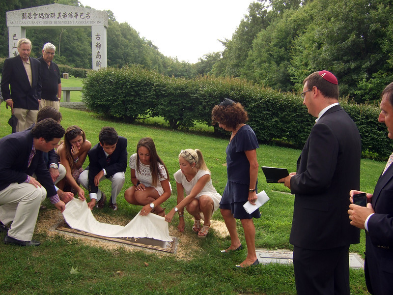 Elliot Walsey gravestone unveiling -  FRONT: Brian Hyman, left front; Jeremy Solomon, 2nd on left front; Alexandra Solomon, 3rd on left front; Jackie Hyman, 4th on right; Gabriela Lynne Hyman, 3rd on right; Lindsay Sarah Hyman, 2nd on right; Joan (née Somerstein) Walsey, right  REAR: Ric Berry, center rear; Irwin Solomon, right rear FRONT RIGHT: Rabbi on left; and Alex Hyman, right - Husband Elliot Walsey's gravestone unveiling