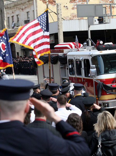 E.L. Hubbard for the Telegraph<br /> Firefighters salute as one of two fire engines arrive with the flag-draped coffins at St. Peter in Chains Cathedral Wednesday, 04/09/2008.