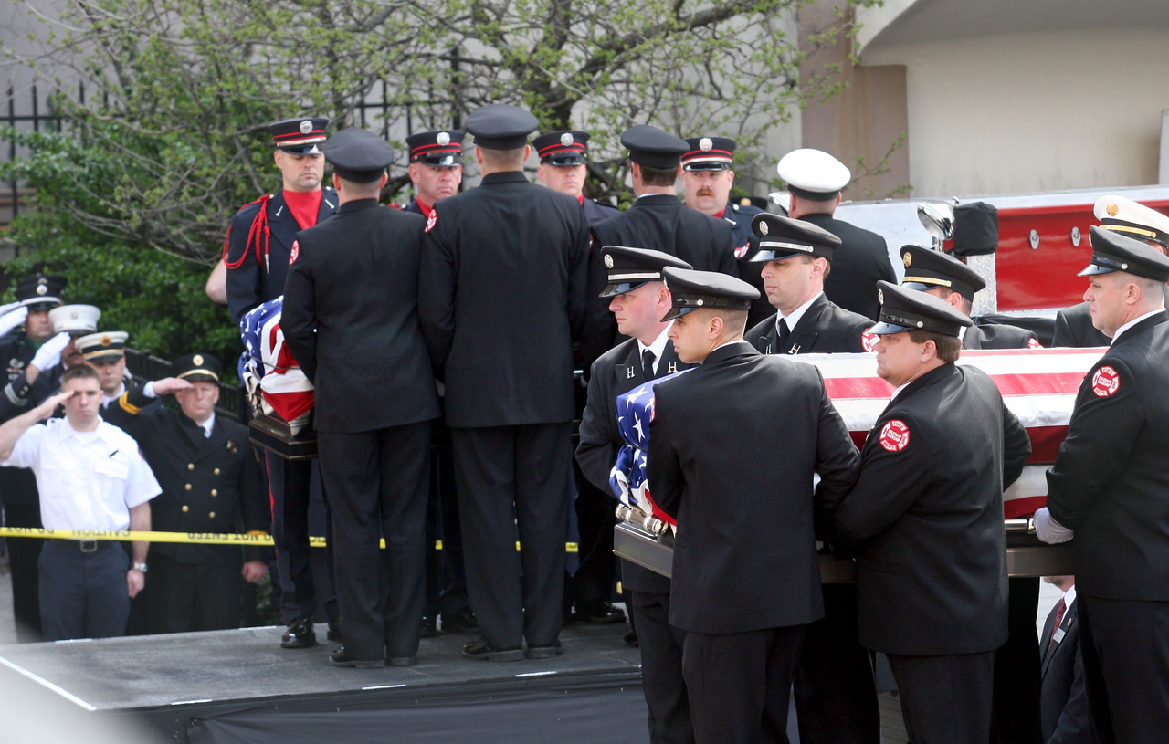 E.L. Hubbard for the Telegraph<br /> Firefighters take the caskets of their fallen comrades from the fire trucks at St. Peter in Chains Cathedral for the funeral Wednesday, 04/09/2008.