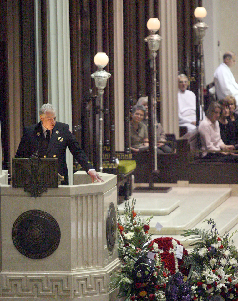 """E.L. Hubbard for the Telegraph<br /> Colerain Township Fire Chief Bruce Smith speaks during the firefighters' funeral at the Cathedral of Saint Peter in Chains Wednesday, 04/09/2008. """"We're very proud of Robin and Brian."""""""