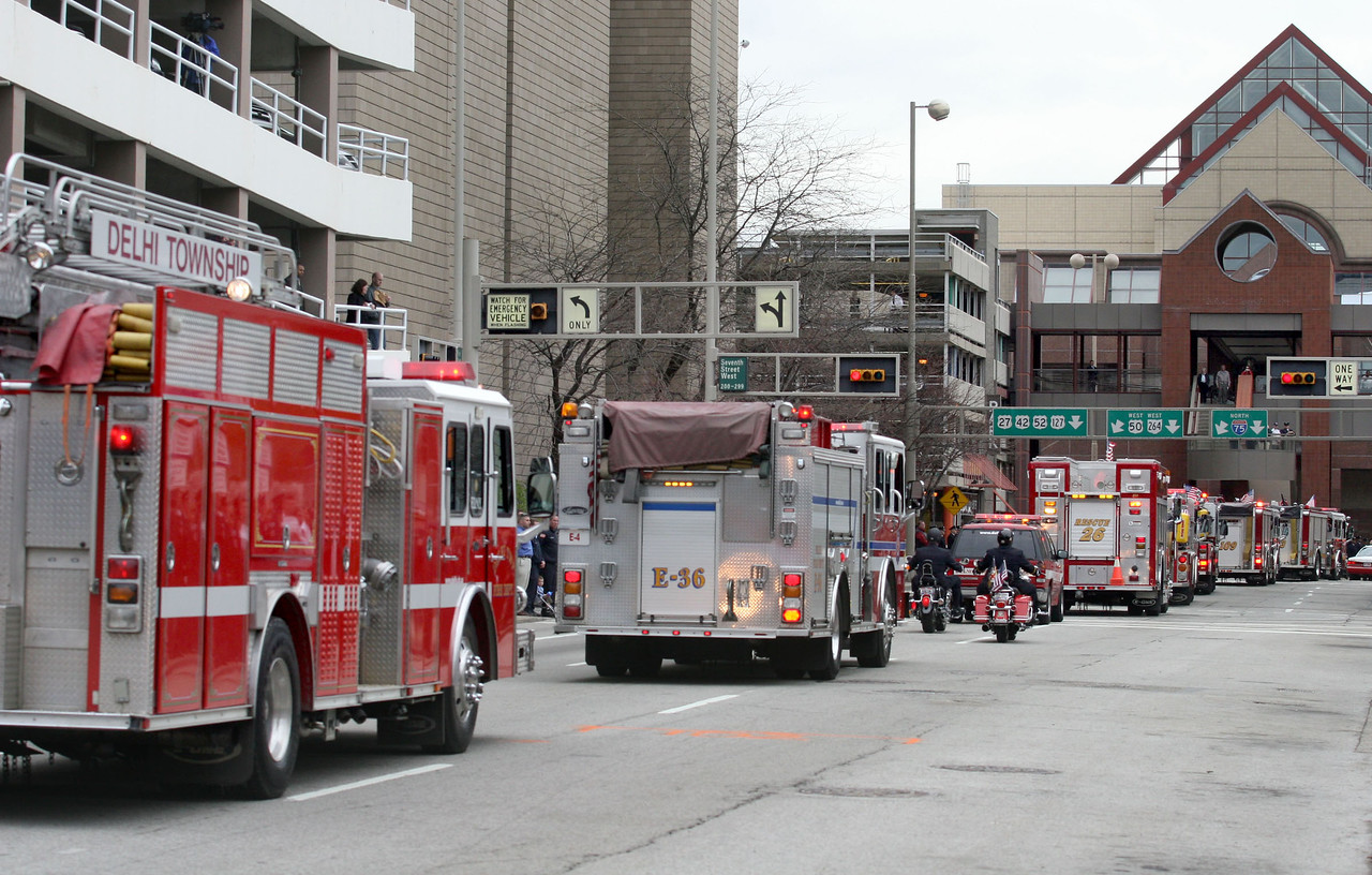 E.L. Hubbard for the Telegraph<br /> The funeral procession leaves the church for Spring Grove Cemetery, with fire apparatus from around the tri-state and beyond, Wednesday, 04/09/2008.