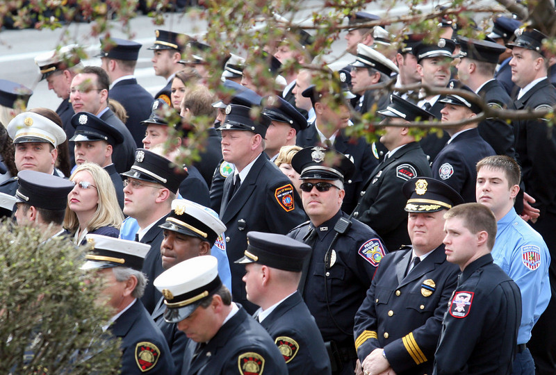 E.L. Hubbard for the Telegraph<br /> Uniformed firefighters line both sides of the street around St. Peter in Chains Cathedral for the funeral of two fallen firefighters Wednesday, 04/09/2008.