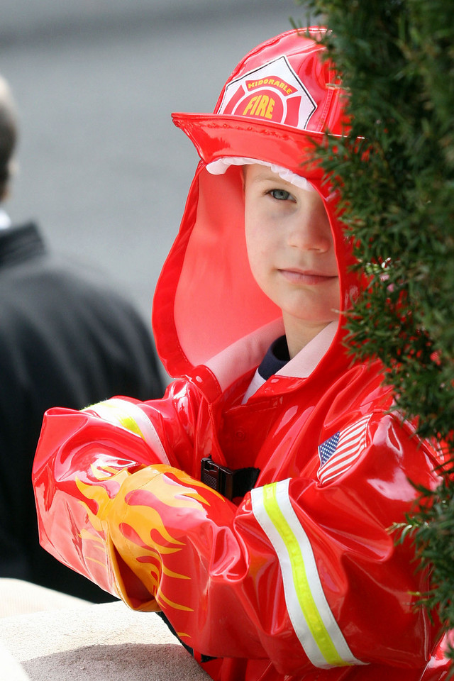E.L. Hubbard for the Telegraph<br /> A young boy wears his firefighter gear as he stands outside St. Peter in Chains Cathedral for the funeral of two fallen firefighters Wednesday, 04/09/2008.