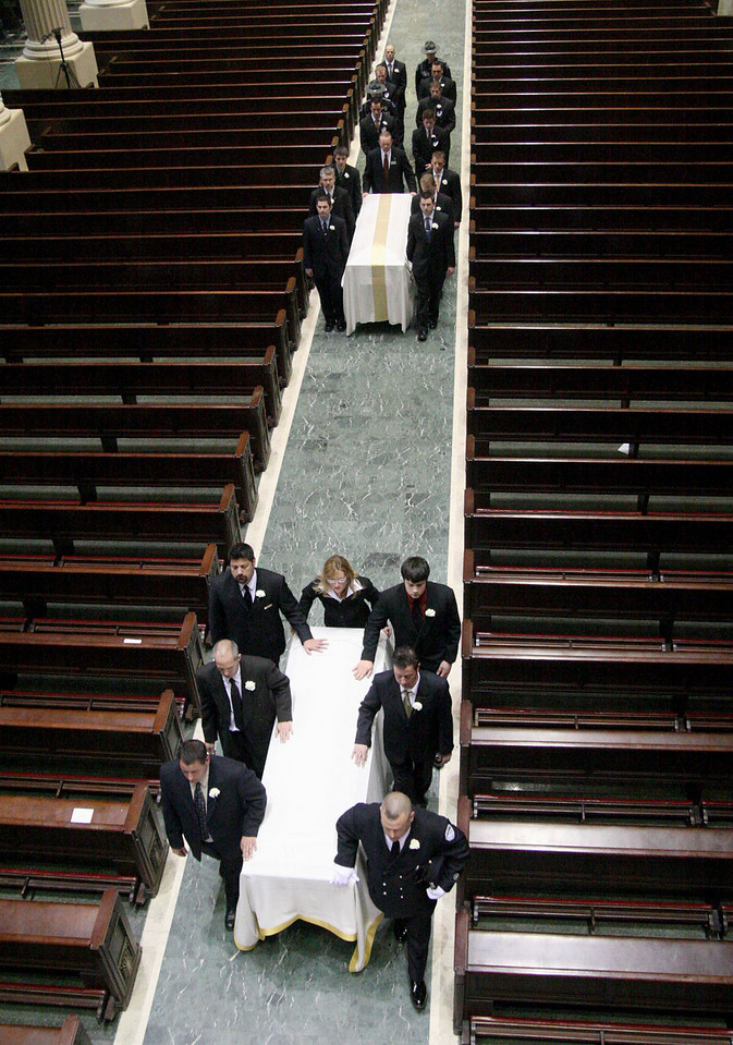E.L. Hubbard for the Telegraph<br /> Firefighter Don Patterson, front right, the fiance of Robin Broxterman, and other pallbearers escort fallen firefighters Broxterman and Brian Schira down the aisle of the Cathedral of Saint Peter in Chains after the funeral service Wednesday, 04/09/2008.