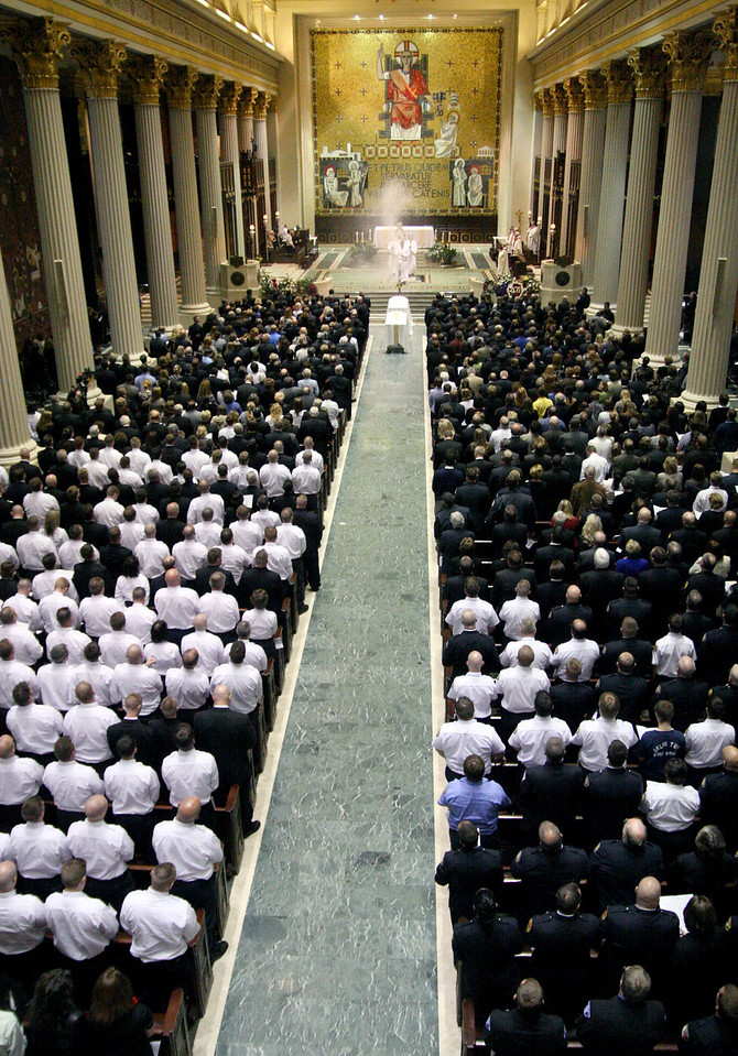 E.L. Hubbard for the Telegraph<br /> Uniformed firefighters, family members, and friends fill the Cathedral of St. Peter in Chains during the funeral Wednesday, 04/09/2008.