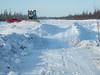 On the James Bay Winter Road between Moosonee and Fort Albany. Working on snow bridge.