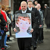 Boucher Funeral Home employee Paul Cormier carries a photo of 8-year-old Colby O'Brien out from Our Lady of the Holy Rosary Church in Gardner after the funeral service on Friday for Colby who died on February 8, 2014 after a large TV and cart fell on him at an after school program at Elm St. School in Gardner. Lining the sides are teachers from Elm St. School.<br /> SENTINEL & ENTERPRISE / BRETT CRAWFORD