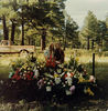 Aug 1977: Marvel and Mother/Virginia at Connie's grave next day.  Some of the flowers from her funeral.  The whole Methodist Church (largest in town) was full of flowers and griefing family and friends.  Many businesses closed during her services and they did for her grandfather Mark Amyx in 1946.