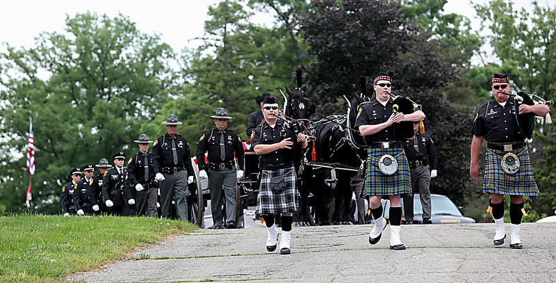 "The casket of former Butler County Sheriff Harold Donald ""Don"" Gabbard is escorted to his final resting place during services at Rose Hill Burial Park in Hamilton Saturday, June 4, 2016."