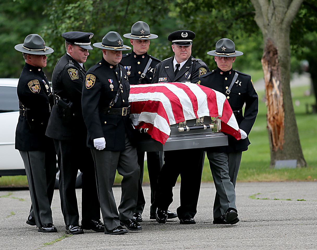 """Pallbearers from the Butler County Sheriff's Office and Hamilton Police Dept. carry the casket of former Butler County Sheriff Harold Donald """"Don"""" Gabbard during services at Rose Hill Burial Park in Hamilton Saturday, June 4, 2016."""