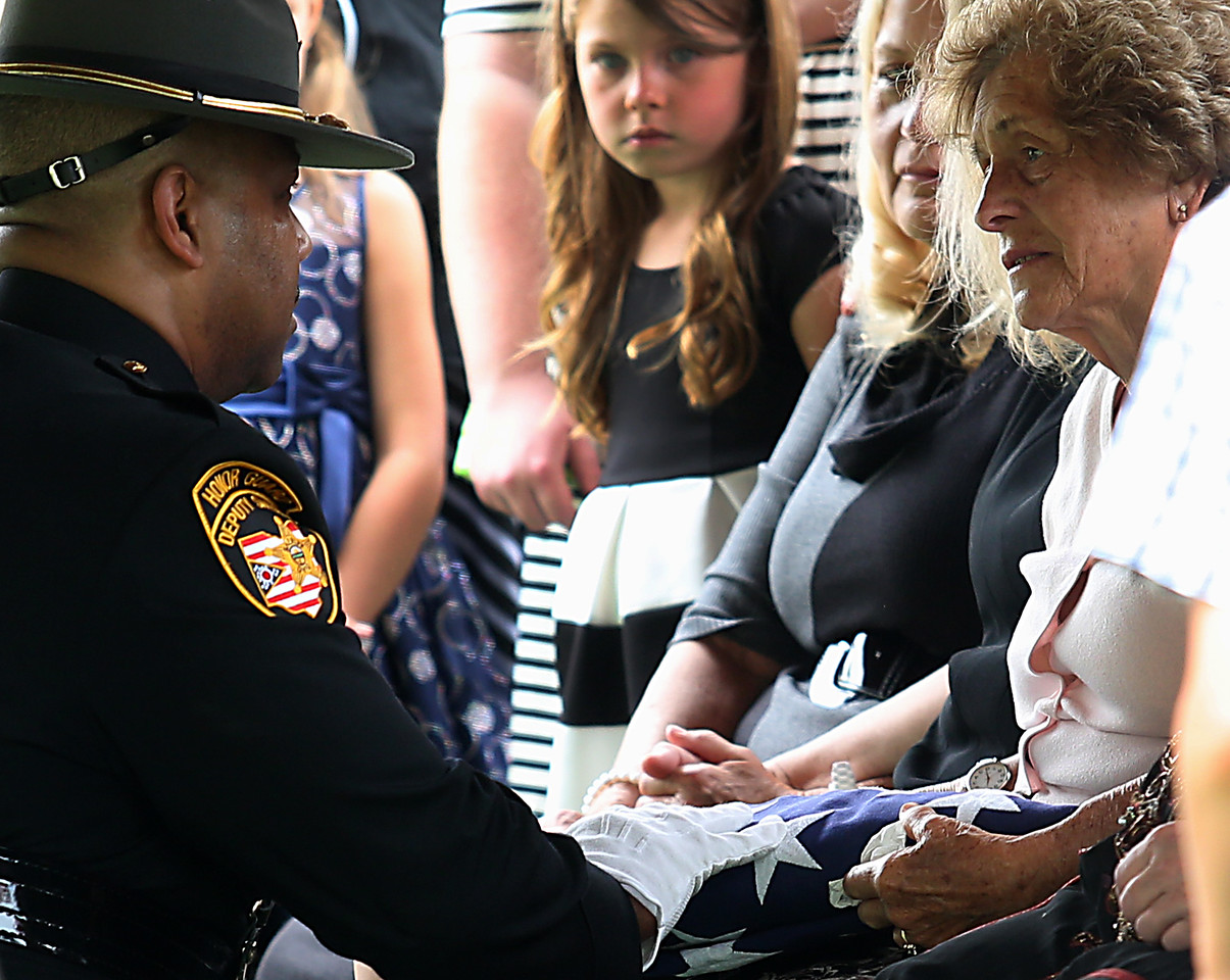"""Phyllis Gabbard, widow of former Butler County Sheriff Harold Donald """"Don"""" Gabbard, is presented with the flag from his casket during services at Rose Hill Burial Park in Hamilton Saturday, June 4, 2016."""