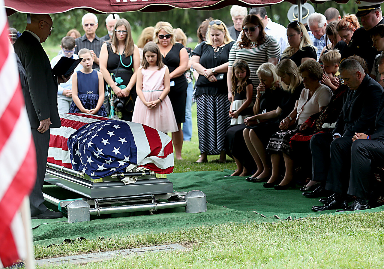 """Family and friends of former Butler County Sheriff Harold Donald """"Don"""" Gabbard gather for graveside services at Rose Hill Burial Park in Hamilton Saturday, June 4, 2016."""