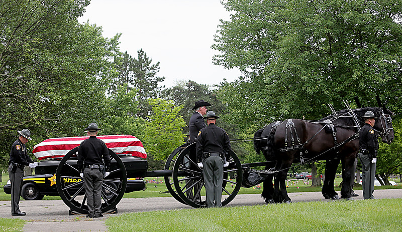"The casket of former Butler County Sheriff Harold Donald ""Don"" Gabbard is moved onto a caisson during services at Rose Hill Burial Park in Hamilton Saturday, June 4, 2016."