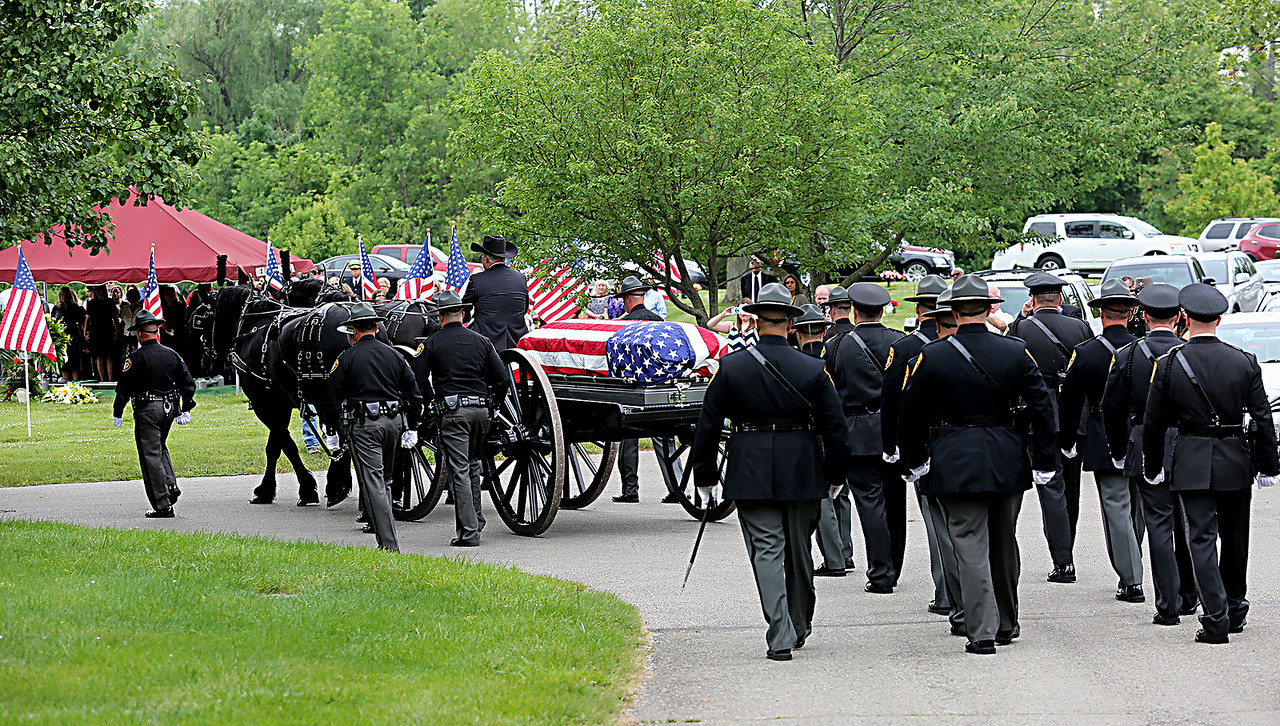 """The casket of former Butler County Sheriff Harold Donald """"Don"""" Gabbard is escorted to his final resting place during services at Rose Hill Burial Park in Hamilton Saturday, June 4, 2016."""