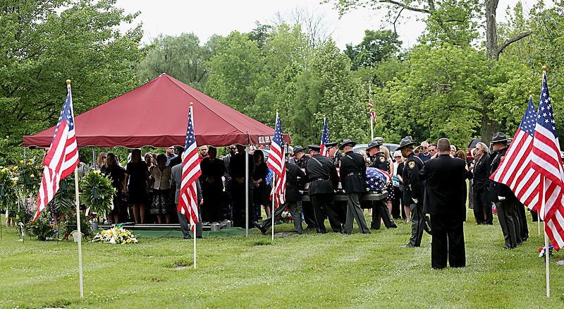 "Pallbearers from the Butler County Sheriff's Office and Hamilton Police Dept. carry the casket of former Butler County Sheriff Harold Donald ""Don"" Gabbard during services at Rose Hill Burial Park in Hamilton Saturday, June 4, 2016."