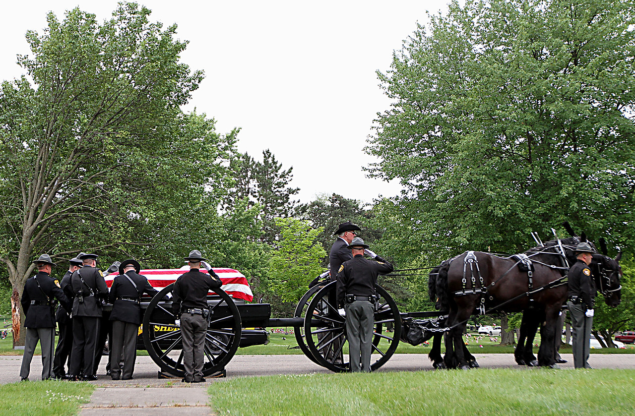 """The casket of former Butler County Sheriff Harold Donald """"Don"""" Gabbard is moved onto a caisson during services at Rose Hill Burial Park in Hamilton Saturday, June 4, 2016."""