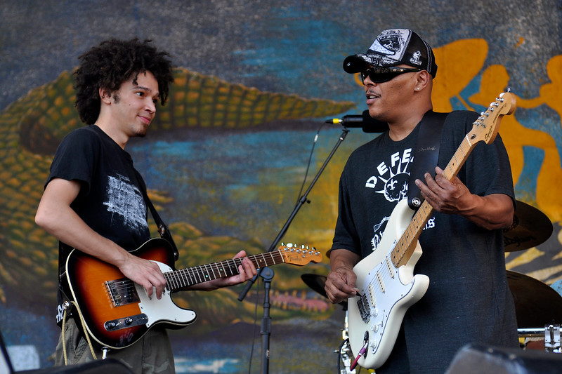 Ian and Ivan Neville performing with Dumpstaphunk at the New Orleans Jazz & Heritage Festival on April 25, 2009.