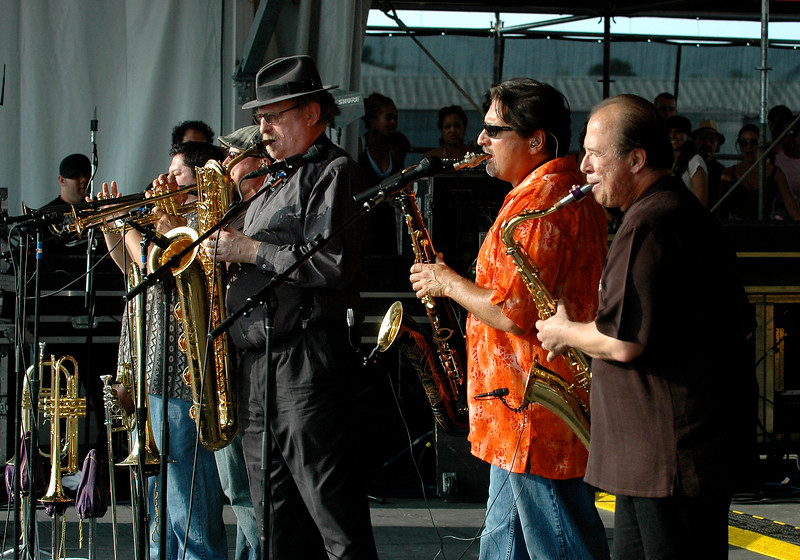 """Tower of Power performing live on stage at the New Orleans Jazz & Heritage Festival on May 1, 2008. ( L-R ) Stephen """"Doc"""" Kupka, Tom E. Politzer, Emilio Castillo."""