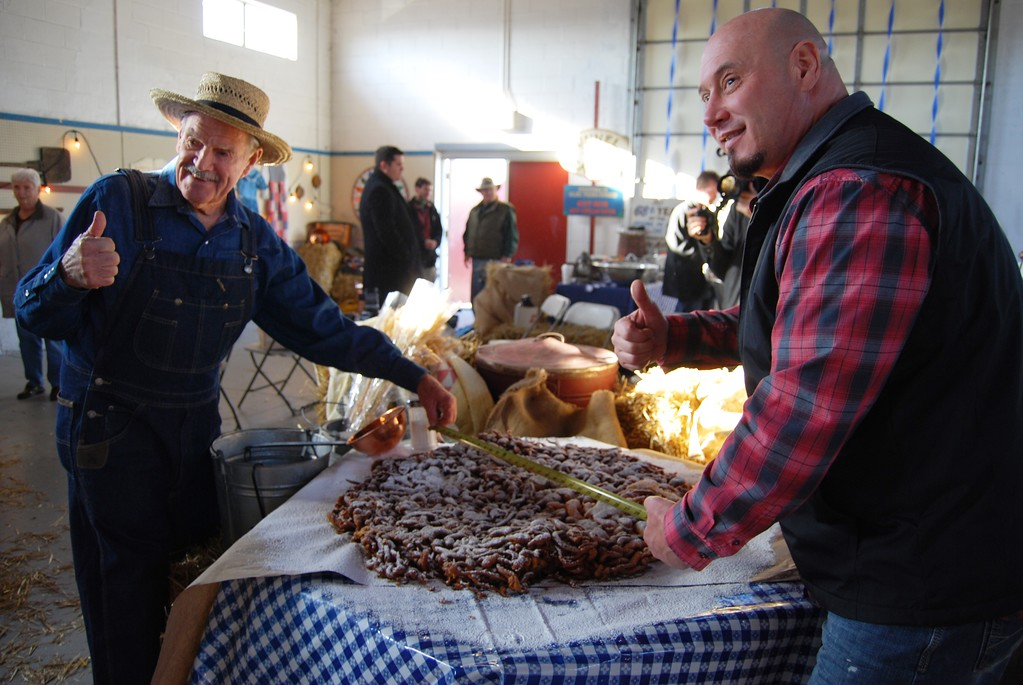 . Celebrity Chef Steve Mallie, with help from Lester Miller of Kutztown, made the world\'s largest funnel cake, measuring 30 inches across, on Nov. 28, 2017. A film crew captured the record-breaking event in front of a crowd of locals gathered at the Kutztown Fairgrounds where funnel cake was born. Miller\'s grandmother Emma and mother Viola introduced the funnel cake at the Kutztown Folk Festival in 1950. Mallie, owner of Mallie\'s Sports Grill & Bar in Detroit, is known for making the world\'s largest burger.  Photos by Lisa Mitchell