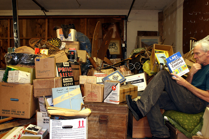 "Clutter Control<br /> <br /> While in Washington State helping my parents move to a smaller home I volunteered to sort through their stuff….<br /> <br />  I had no idea what I was in for or would find… these two photos are showing ONE-HALF of the garage attic contents! ... Their house contents are yet to be done....!<br /> <br /> Among those contents I came across a brand new book titled:<br />  ""1,001 timely tips for<br /> CLUTTER CONTROL<br /> ""Knowing what to keep, what to toss, and how to store your stuff""<br /> <br /> This hardcover book was still in its box but without the box cover and appeared to have never been read… So-- I just had to take these photos!"