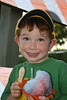 Max - the Shave Ice Poster Boy<br /> <br /> Max and his family were visiting the Kalapana lava flow and was sitting outside my lava photo booth and after getting permission I snapped this photo; a totally spontaneous pose.<br /> <br /> (Anyone remember Norman Rockwell? :)