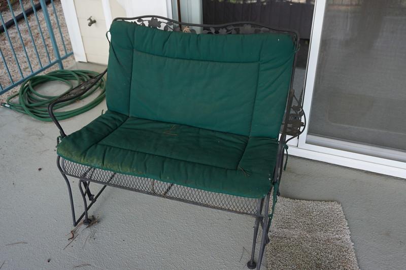 MAYBE: Iron patio rocker