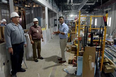 Tania Barricklo-Daily Freeman    Ulster County Executive Mike Hein, far right, led a walk through for the press Wednesday morning of the construction site of the future Ulster County Family Court. The building will be located in former Business Resource Center on Ulster Ave. in the town of Ulster.To the left are Construction Manager Jake Blosser,left, and Ulster County Head of Facilities Dave Gruskiewicz.