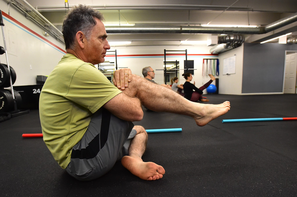 . Rick Epstein works an ankle mobility exercise in the Future Proof Movement Mobility Class on Tuesday in Boulder. For more photos go to dailycamera.com Paul Aiken Staff Photographer April 10, 2018