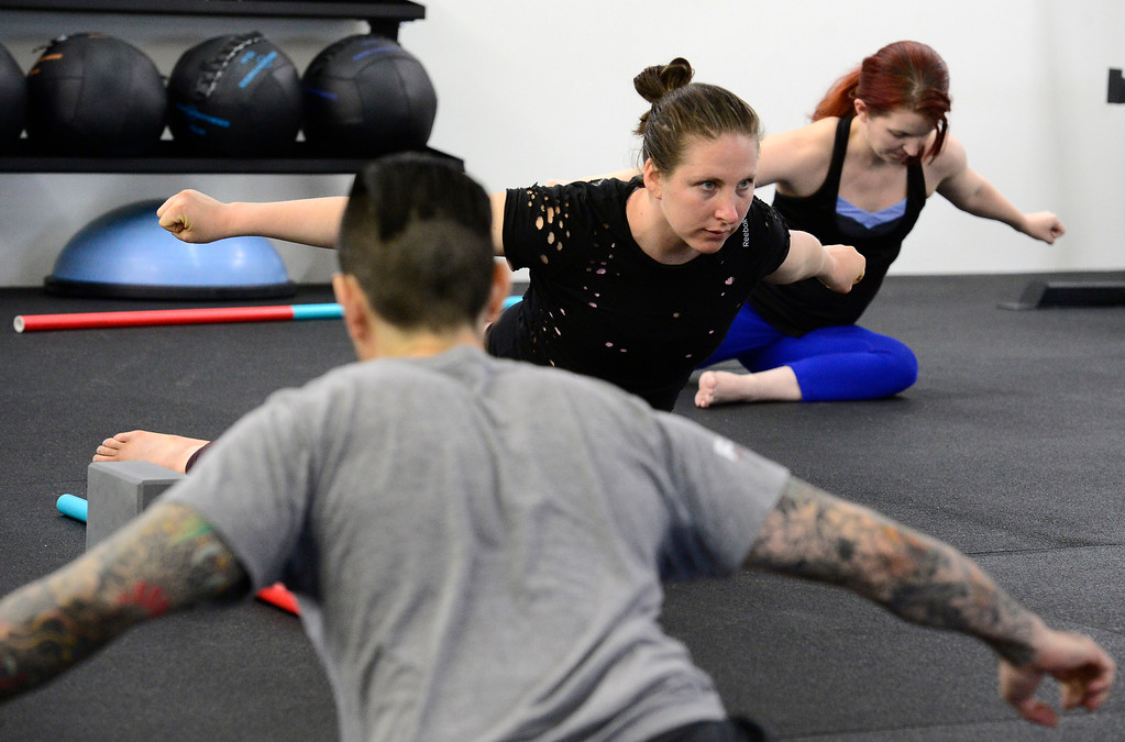 . Abby Maroko leans forward in a hip stretch during the Future Proof Movement Mobility Class on Tuesday in Boulder. For more photos go to dailycamera.com Paul Aiken Staff Photographer April 10, 2018