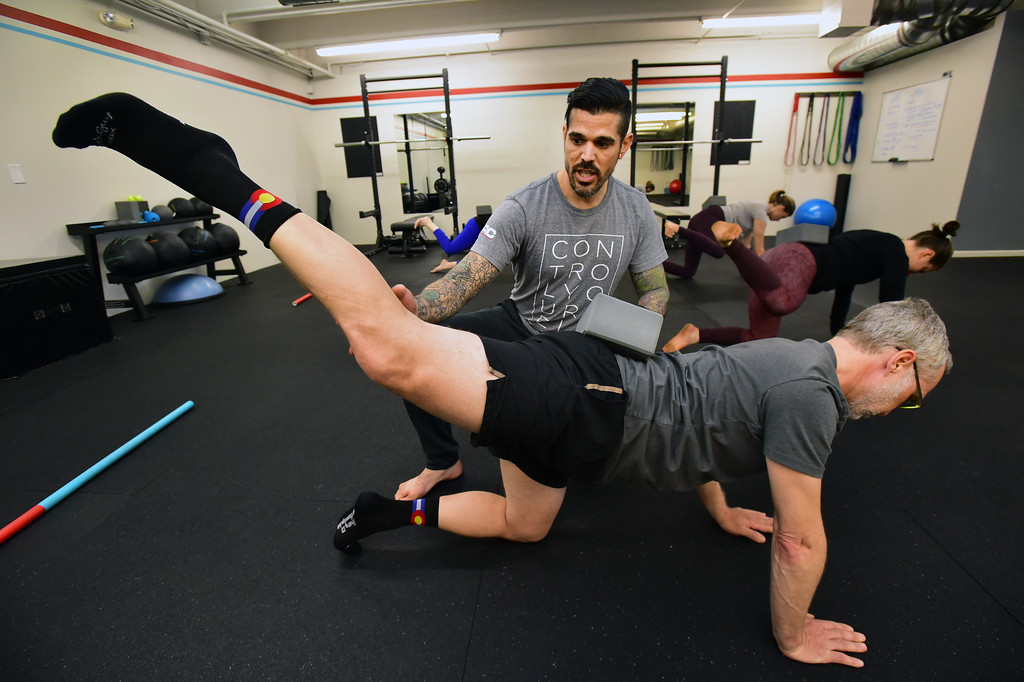 . Instructor Erik Gutierrez uses a block to check Paul Teven\'s body position in the Future Proof Movement Mobility Class on Tuesday in Boulder. For more photos go to dailycamera.com Paul Aiken Staff Photographer April 10, 2018