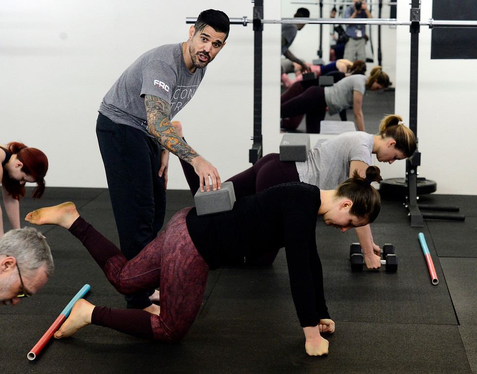 . Instructor Erik Gutierrez uses a block to check Abby Maroko\'s body position in the Future Proof Movement Mobility Class on Tuesday in Boulder. For more photos go to dailycamera.com Paul Aiken Staff Photographer April 10, 2018
