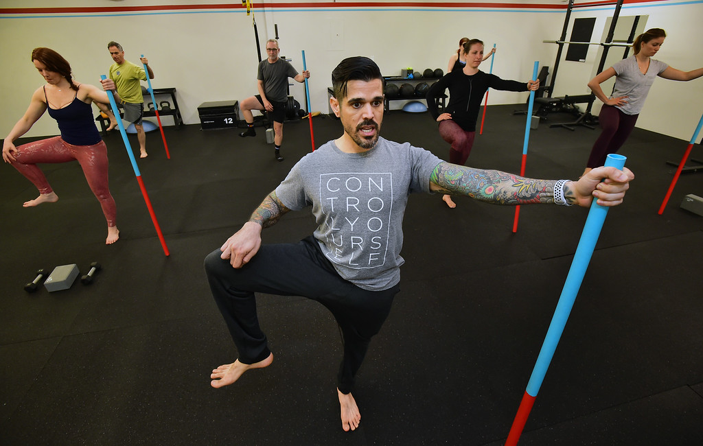 . Instructor Erik Gutierrez leads the class in a hip stretch in the Future Proof Movement Mobility Class on Tuesday in Boulder. For more photos go to dailycamera.com Paul Aiken Staff Photographer April 10, 2018